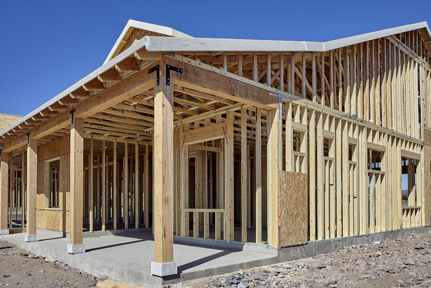 56976080 - new housing wood frame construction industry concept photograph of economic recovery
